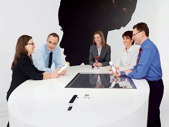 Five employees discussing Beauty Care products