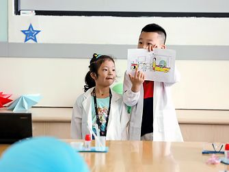 Learning by playing - elementary school children are taught how to handle our planet's resources responsibly. An Xintong and Gan Jiayu are proud of what they've learned at a holiday school in Shanghai, China.